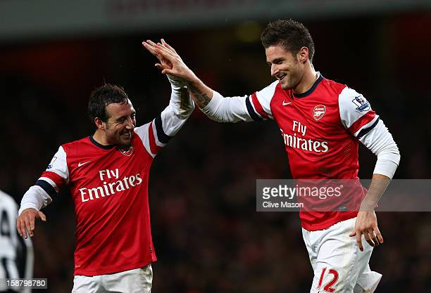 Olivier Giroud of Arsenal celebrates scoring their fifth goal with Santi Cazorla of Arsenal during the Barclays Premier League match between Arsenal...