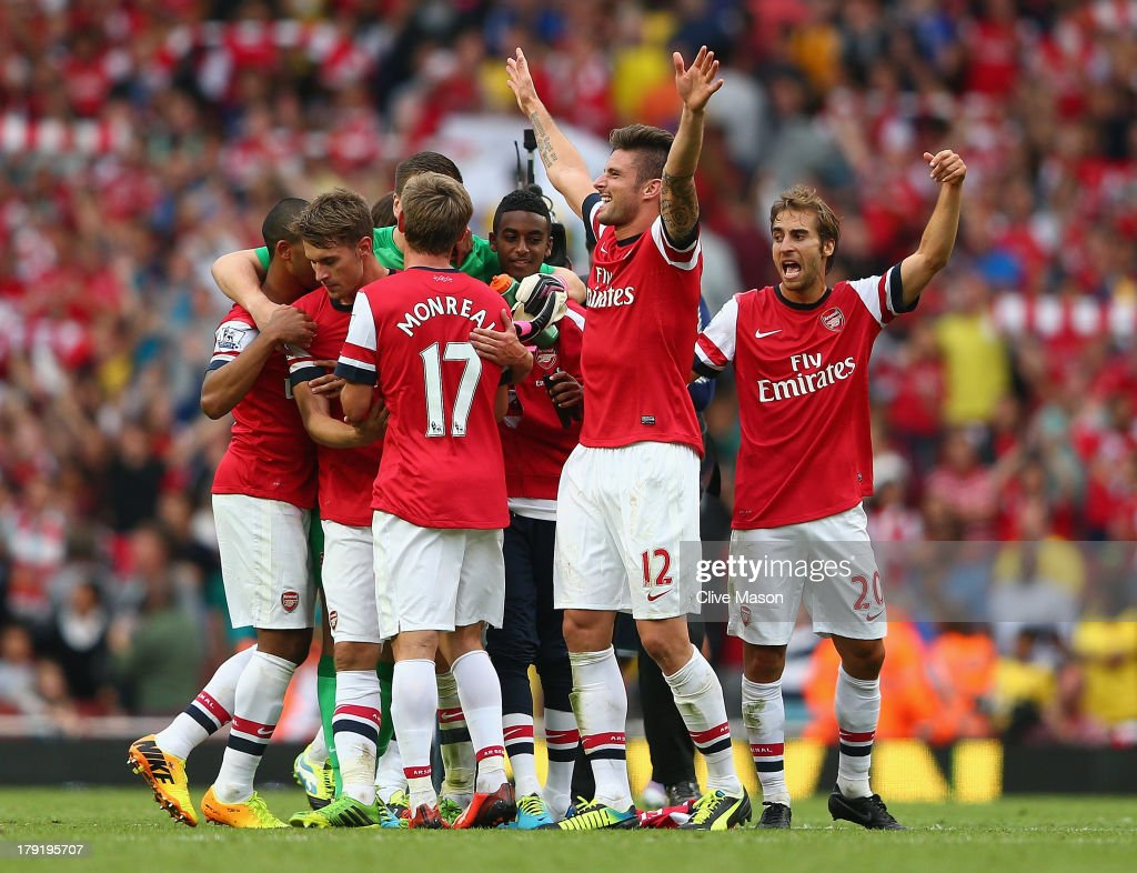 Olivier Giroud of Arsenal celebrates victory after the Barclays Premier League match between Arsenal and Tottenham Hotspur at Emirates Stadium on September 01, 2013 in London, England.