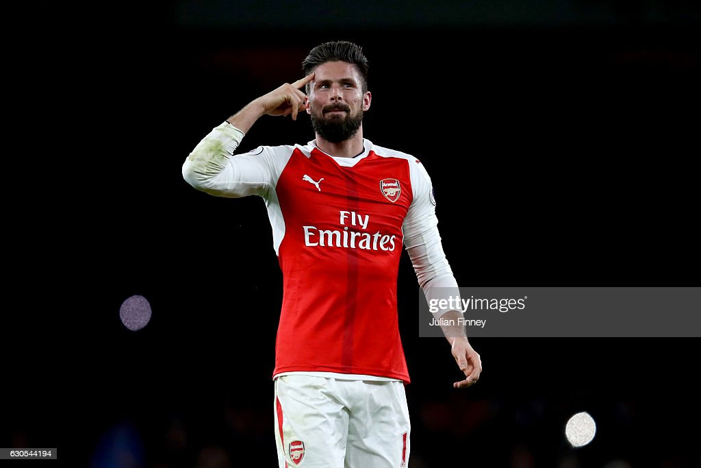 Olivier Giroud of Arsenal celebrates victory after the Premier League match between Arsenal and West Bromwich Albion at Emirates Stadium on December 26, 2016 in London, England.