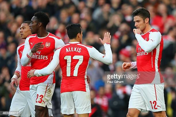 Olivier Giroud of Arsenal celebrates with Alexis Sanchez and Danny Welbeck of Arsenal after scoring the opening goal during the FA Cup fifth round...