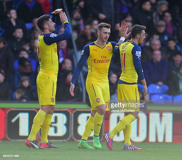 Olivier Giroud of Arsenal celebrates with Calum Chambers and Mesut Oezil as he scores their second goal during the Barclays Premier League match...