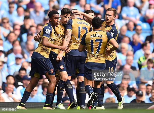 Olivier Giroud of Arsenal celebrates with his team mates after scoring his side's first goal during the Barclays Premier League match between...