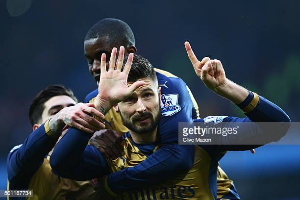 Olivier Giroud of Arsenal celebrates with Joel Campbell as he scores their first goal from a penalty during the Barclays Premier League match between...