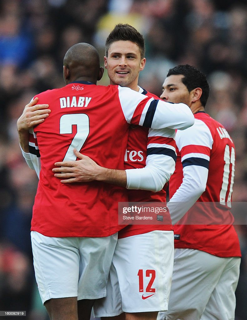 Olivier Giroud of Arsenal (12) celebrates with team mate Abou Diaby as he scores their first goal during the FA Cup with Budweiser Fourth Round match between Brighton & Hove Albion and Arsenal at Amex Stadium on January 26, 2013 in Brighton, England.