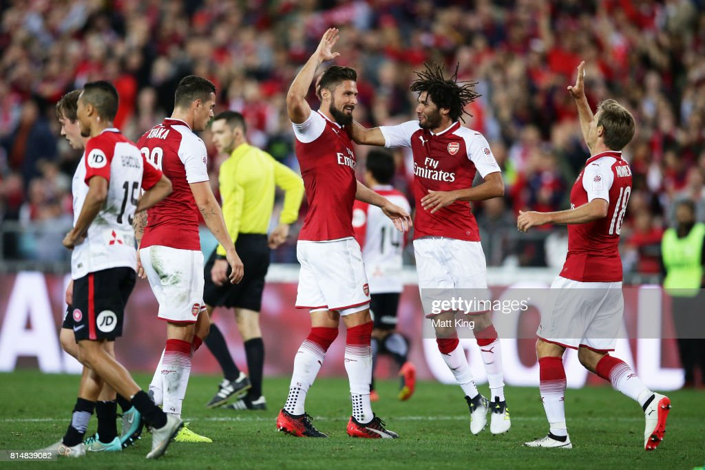 Olivier Giroud of Arsenal celebrates with team mates after scoring a goal during the match between the Western Sydney Wanderers and Arsenal FC at ANZ Stadium on July 15, 2017 in Sydney, Australia.