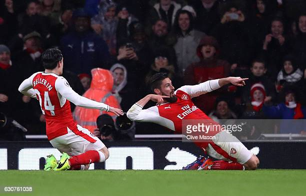 Olivier Giroud of Arsenal celebrates with teammate Hector Bellerin after scoring the opening goal during the Premier League match between Arsenal and...