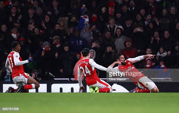 Olivier Giroud of Arsenal celebrates with teammates after scoring the opening goal during the Premier League match between Arsenal and Crystal Palace...