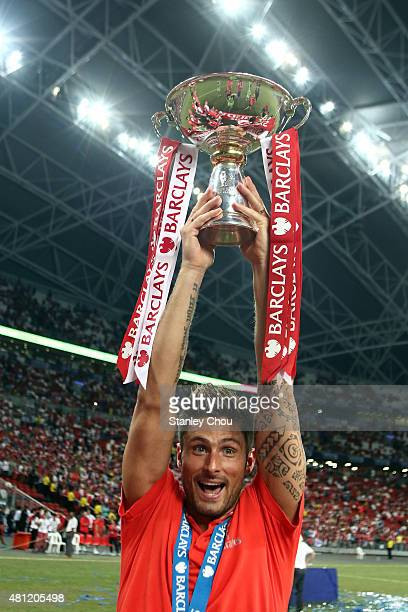 Olivier Giroud of Arsenal celebrates with the trophy after they defeated Everton 31 during the Barclays Asia Trophy final match between Arsenal and...
