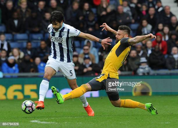 Olivier Giroud of Arsenal challenges Claudio Yacob of WBA during the Premier League match between West Bromwich Albion and Arsenal at The Hawthorns...