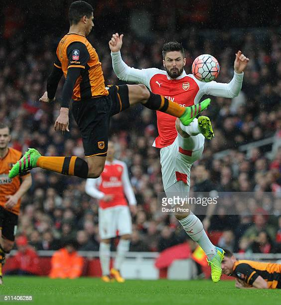 Olivier Giroud of Arsenal challenges Curtis Davies of Hull during the match between Arsenal and Hull City in the FA Cup 5th Round at Emirates Stadium...