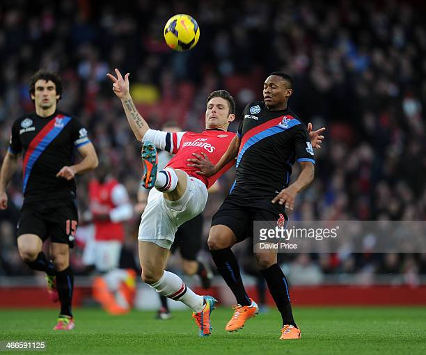 Olivier Giroud of Arsenal challenges Kagisho Dikgacoi of Palace during the match between Arsenal and Crystal Palace in the Barclays Premier League at...