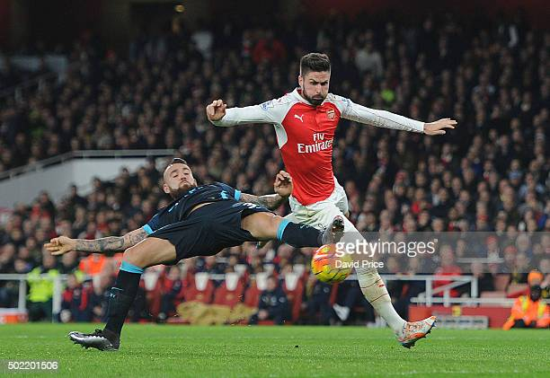 Olivier Giroud of Arsenal challenges Nicolas Otamendi of Man City during the Barclays Premier League match between Arsenal and Manchester City at...
