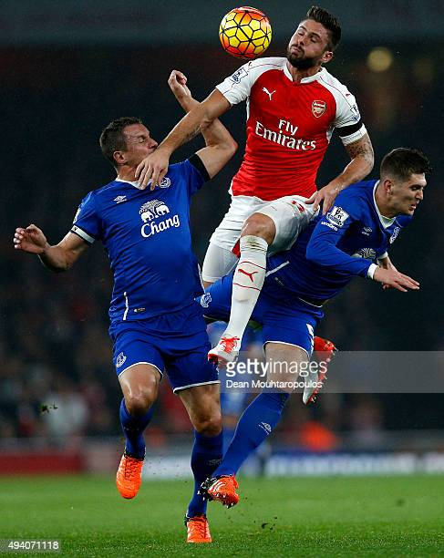 Olivier Giroud of Arsenal competes for the ball against Phil Jagielka and John Stones of Everton during the Barclays Premier League match between...