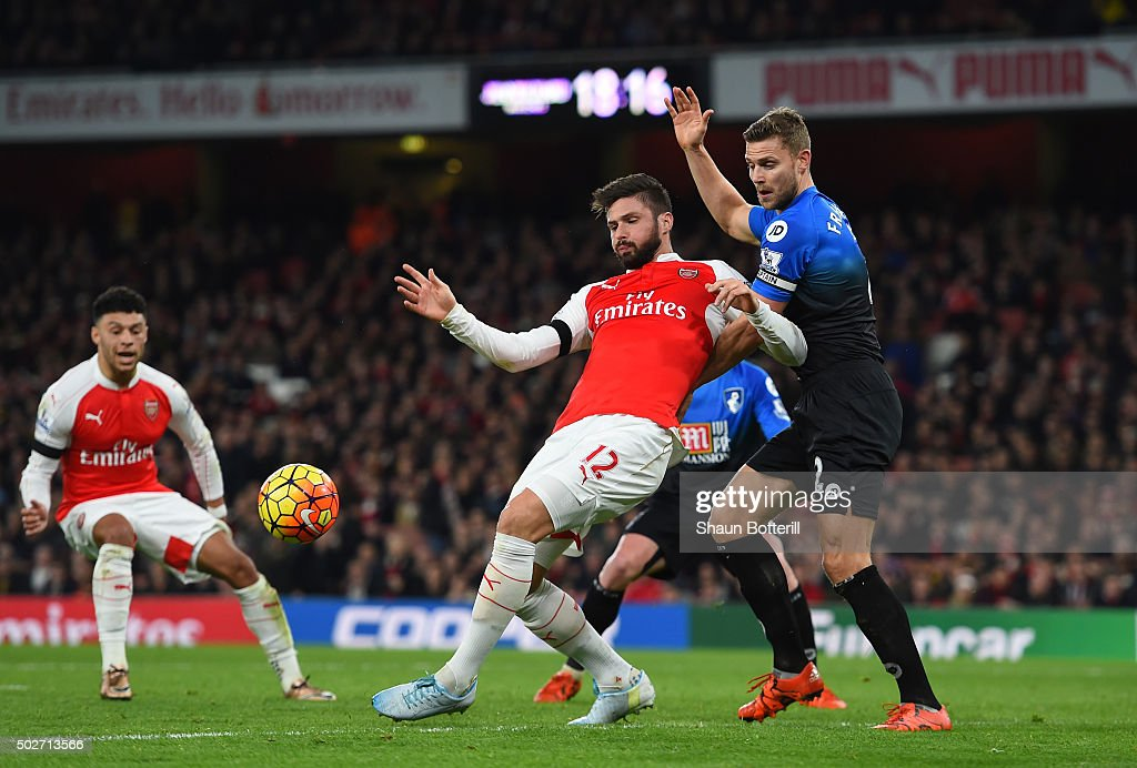 Olivier Giroud of Arsenal controls the ball under pressure of Simon Francis of Bournemouth during the Barclays Premier League match between Arsenal and A.F.C. Bournemouth at Emirates Stadium on December 28, 2015 in London, England.