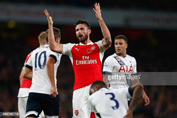 Olivier Giroud of Arsenal encourages the Arsenal supporters during the Barclays Premier League match between Arsenal and Tottenham Hotspur at the...