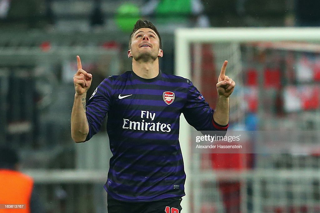 Olivier Giroud of Arsenal FC celebrates scoring the opening goal during the UEFA Champions League Round of 16 second leg match between Bayern Muenchen and Arsenal at Allianz Arena on March 13, 2013 in Munich, Germany.