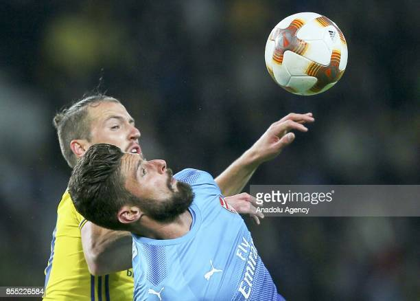 Olivier Giroud of Arsenal FC in action against Nemanja Milunovic of BATE Borisov during the UEFA Europa League group H match between BATE Borisov and...