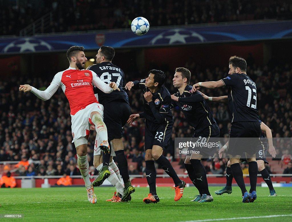 Olivier Giroud of Arsenal heads the ball towards goal under pressure from (L-R) Jeremy Taravel, Leonardo Sigali, Marko Pjaca and Goncalo Santos of Zagreb during the match between Arsenal and Dinamo Zagreb in the UEFA Champions League on November 24, 2015 in London, United Kingdom.