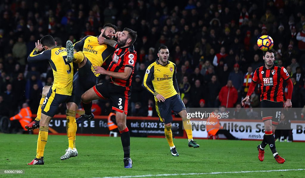 Olivier Giroud (2nd L) of Arsenal heads to score his team's third goal during the Premier League match between AFC Bournemouth and Arsenal at Vitality Stadium on January 3, 2017 in Bournemouth, England.