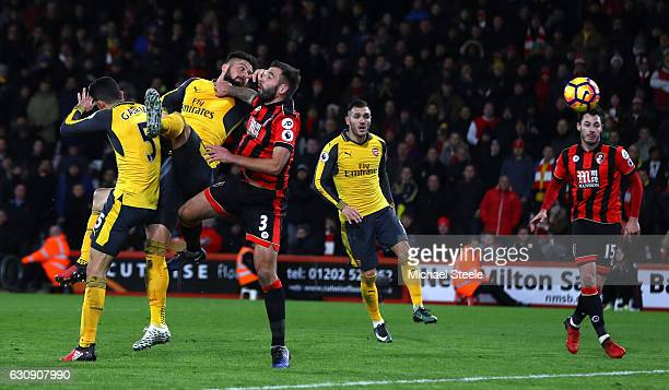 Olivier Giroud of Arsenal heads to score his team's third goal during the Premier League match between AFC Bournemouth and Arsenal at Vitality...