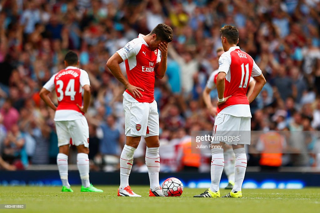 Olivier Giroud of Arsenal holds his head after they conceded a second goal during the Barclays Premier League match between Arsenal and West Ham United at the Emirates Stadium on August 9, 2015 in London, England.