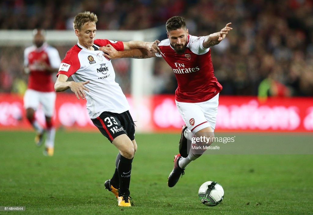 Olivier Giroud of Arsenal holds off Michael Thwaite of the Wanderers during the match between the Western Sydney Wanderers and Arsenal FC at ANZ Stadium on July 15, 2017 in Sydney, Australia.
