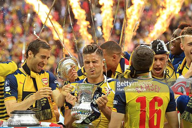 ENGLAND MAY 30 Olivier Giroud of Arsenal holds the FA Cup trophy after the FA Cup Final between Aston Villa and Arsenal at Wembley Stadium on May 30...