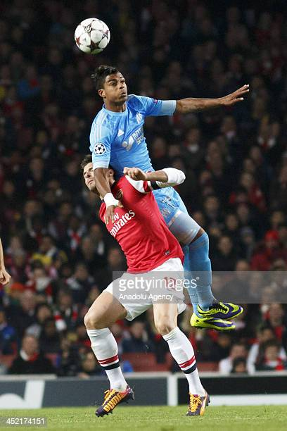 Olivier Giroud of Arsenal in action against Mario Lemina of Marseille during the UEFA Champions League group F football match between Arsenal and...