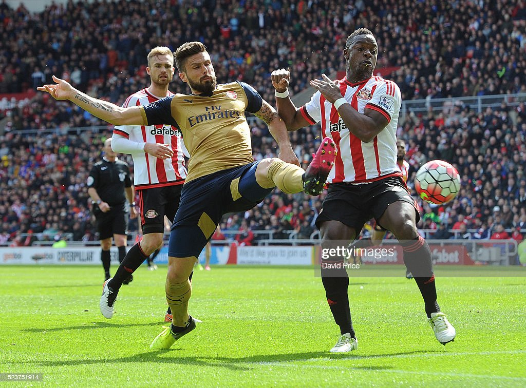 Olivier Giroud of Arsenal is challenged by Lamine Kone of Sunderland during the Barclays Premier League match between Sunderland and Arsenal at The Stadium of Light on April 24th in Sunderland, England