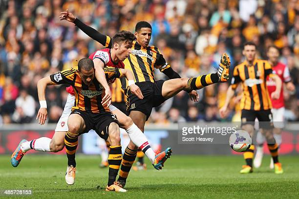 Olivier Giroud of Arsenal is challenged by Liam Rosenior and Curtis Davies of Hull City during the Barclays Premier League match between Hull City...