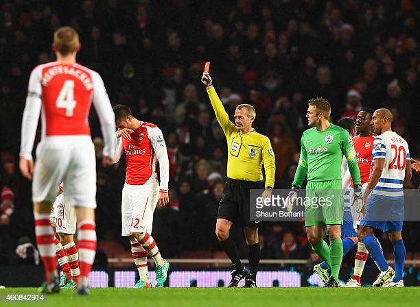 Olivier Giroud of Arsenal is sent off for a head butt on Nedum Onuoha of QPR by referee Martin Atkinson during the Barclays Premier League match...