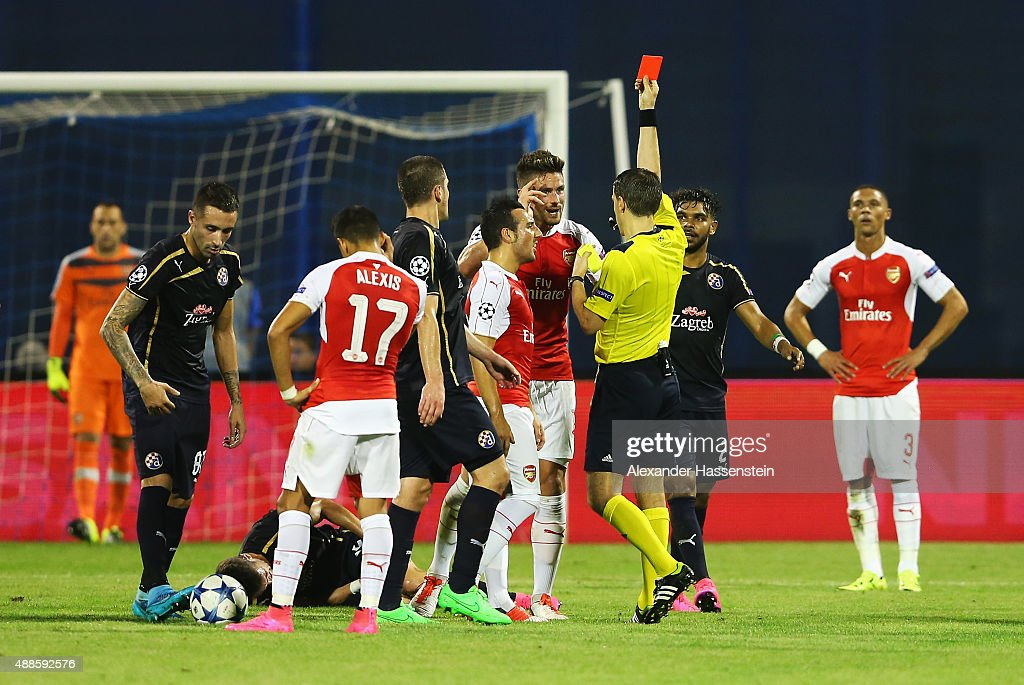Olivier Giroud of Arsenal is shown the red card by referee Ovidiu Hategan during the UEFA Champions League Group F match between Dinamo Zagreb and Arsenal at Maksimir Stadium on September 16, 2015 in Zagreb, Croatia.