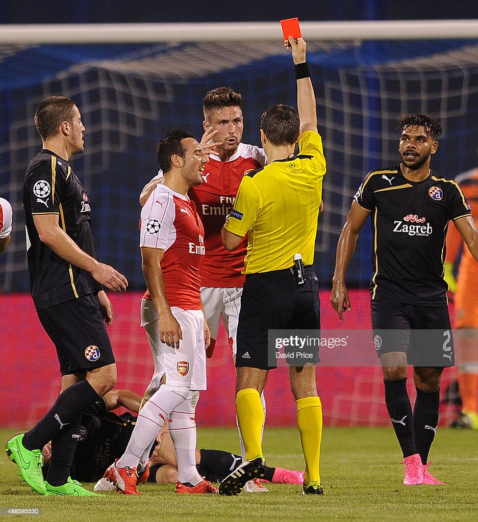 Olivier Giroud of Arsenal is shown the red card by referee Ovidiu Hategan during the match between GNK Dinamo Zagreb and Arsenal on September 16, 2015 in Zagreb, Croatia.