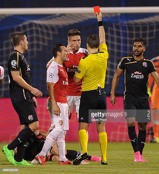 Olivier Giroud of Arsenal is shown the red card by referee Ovidiu Hategan during the match between GNK Dinamo Zagreb and Arsenal on September 16 2015...