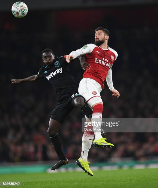 Olivier Giroud of Arsenal jumps with Domingos Quina of West Ham during the Carabao Cup Quarter Final match between Arsenal and West Ham United at...