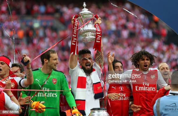 Olivier Giroud of Arsenal lifts the trophy during the Emirates FA Cup Final match between Arsenal and Chelsea at Wembley Stadium on May 27 2017 in...