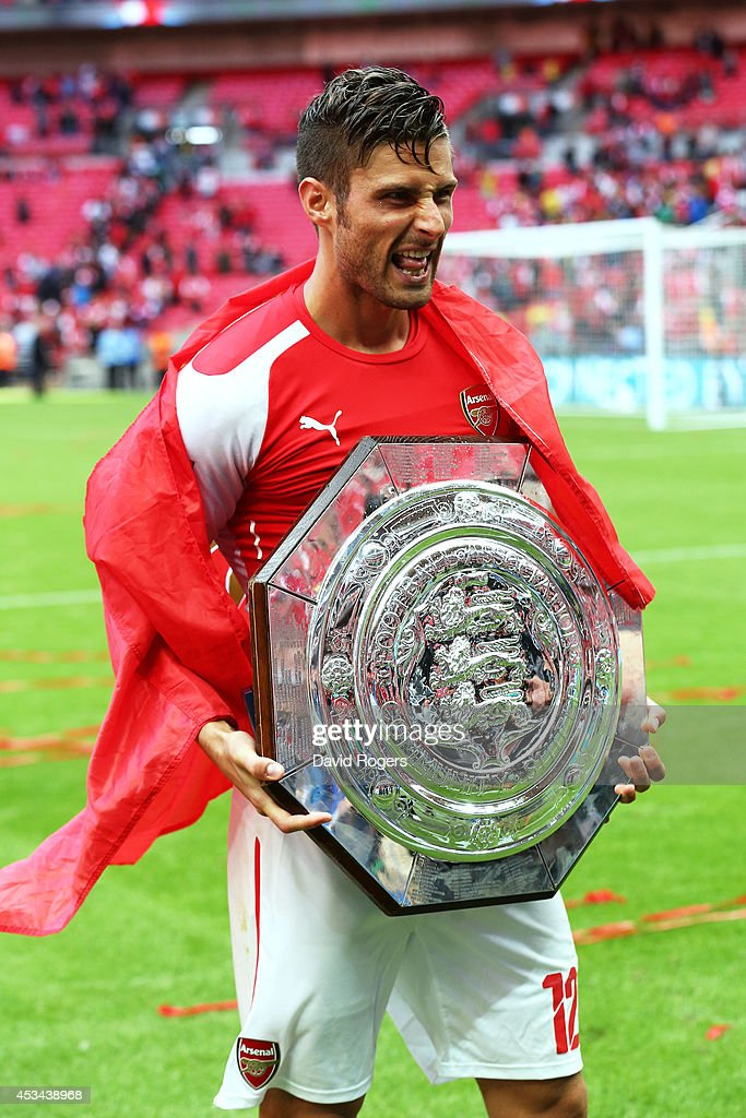 Olivier Giroud of Arsenal poses with the trophy after the FA Community Shield match between Manchester City and Arsenal at Wembley Stadium on August 10, 2014 in London, England.