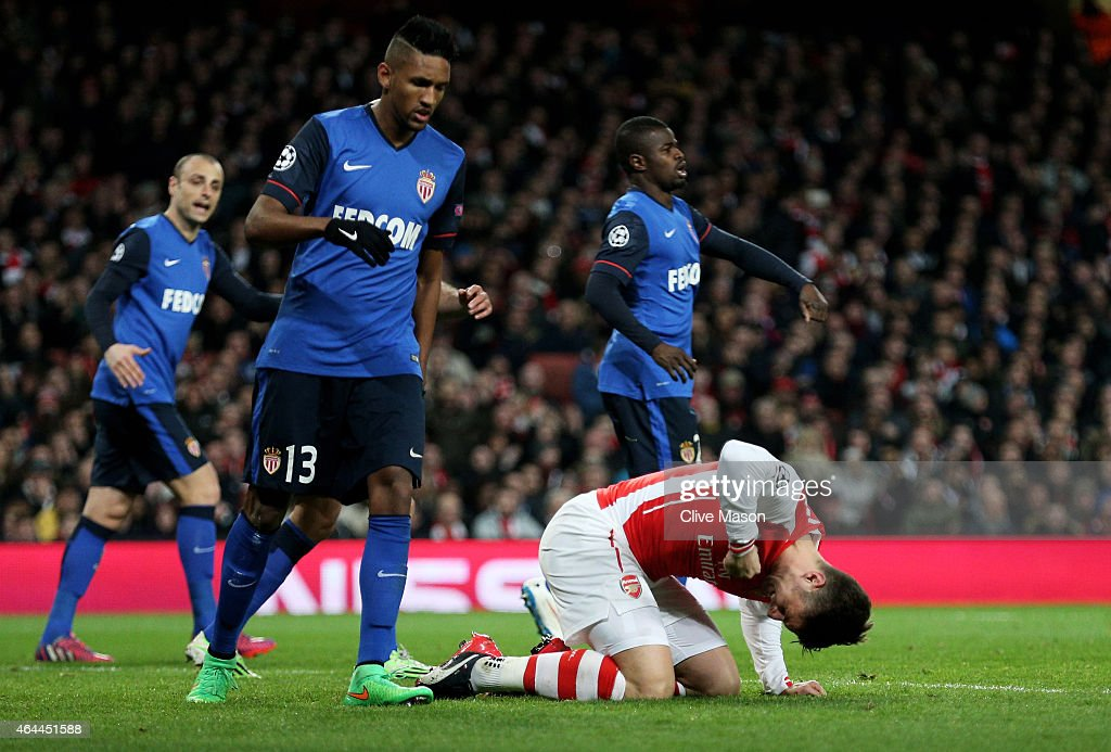 Olivier Giroud of Arsenal punches the grounds after missing a chance on goal during the UEFA Champions League round of 16, first leg match between Arsenal and Monaco at The Emirates Stadium on February 25, 2015 in London, United Kingdom.