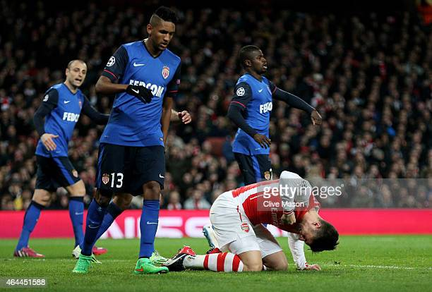 Olivier Giroud of Arsenal punches the grounds after missing a chance on goal during the UEFA Champions League round of 16 first leg match between...
