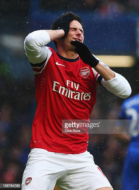 Olivier Giroud of Arsenal reacts after a missed chance during the Barclays Premier League match between Chelsea and Arsenal at Stamford Bridge on...