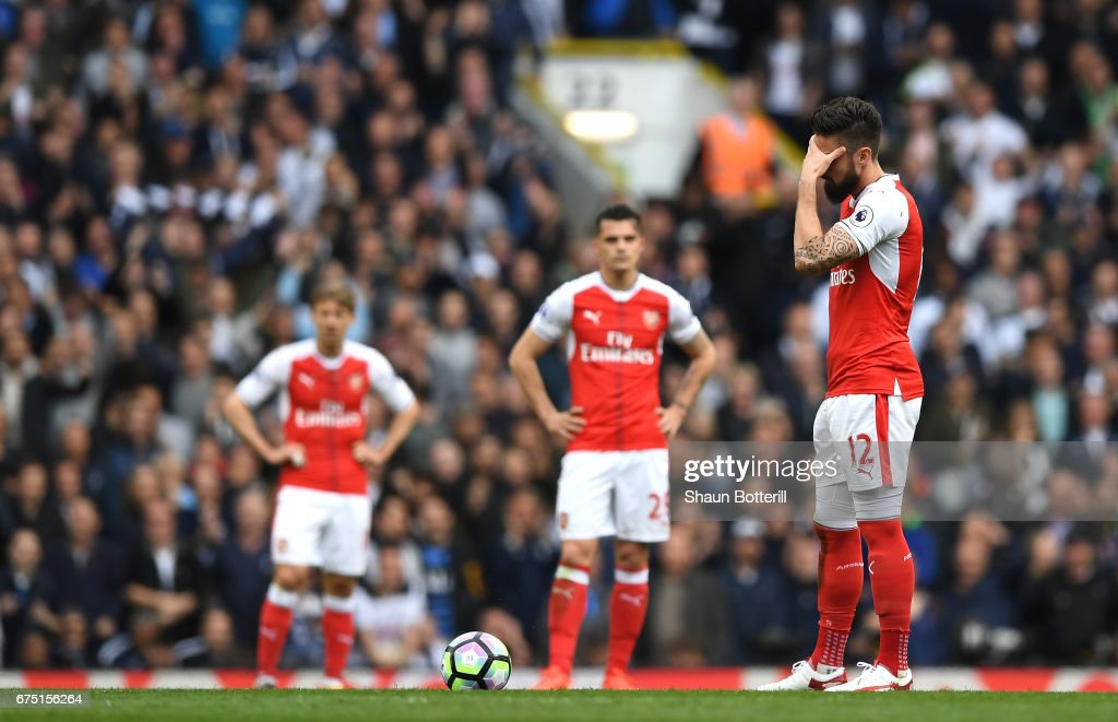 Olivier Giroud of Arsenal reacts to Tottenham Hotspur scoring their second goal during the Premier League match between Tottenham Hotspur and Arsenal at White Hart Lane on April 30, 2017 in London, England.