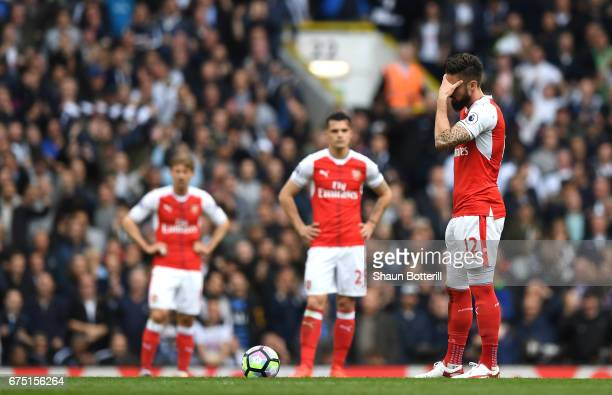 Olivier Giroud of Arsenal reacts to Tottenham Hotspur scoring their second goal during the Premier League match between Tottenham Hotspur and Arsenal...