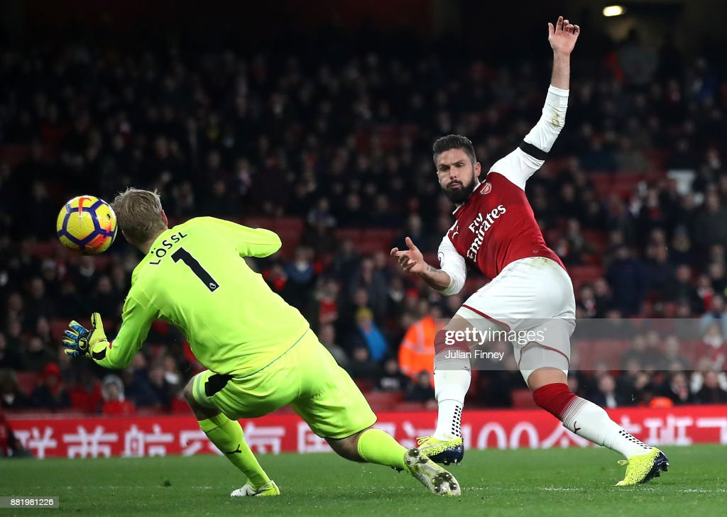 Olivier Giroud of Arsenal scores his sides fifth goal past Jonas Lossl of Huddersfield Town during the Premier League match between Arsenal and Huddersfield Town at Emirates Stadium on November 29, 2017 in London, England.