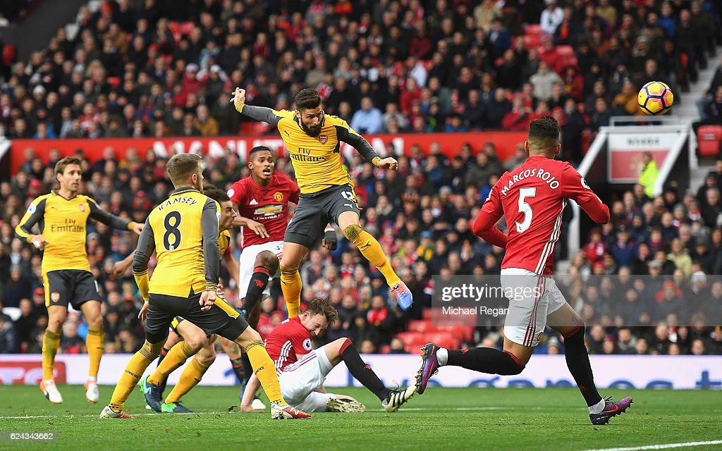 Olivier Giroud of Arsenal (C) scores his sides first goal during the Premier League match between Manchester United and Arsenal at Old Trafford on November 19, 2016 in Manchester, England.