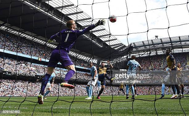 Olivier Giroud of Arsenal scores his side's first goal past Joe Hart of Manchester City during the Barclays Premier League match between Manchester...