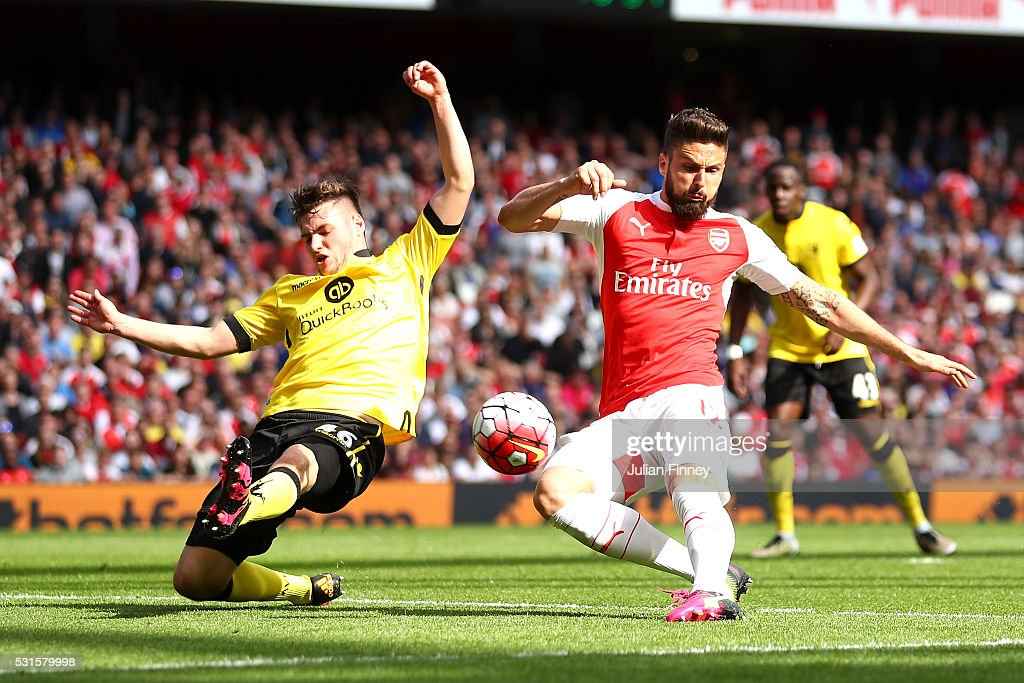 Olivier Giroud of Arsenal scores his team's second goal during the Barclays Premier League match between Arsenal and Aston Villa at Emirates Stadium on May 15, 2016 in London, England.