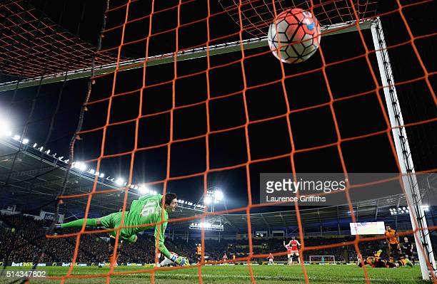 Olivier Giroud of Arsenal scores past Eldin Jakupovic of Hull City for his team's second goal during the Emirates FA Cup Fifth Round Replay match...
