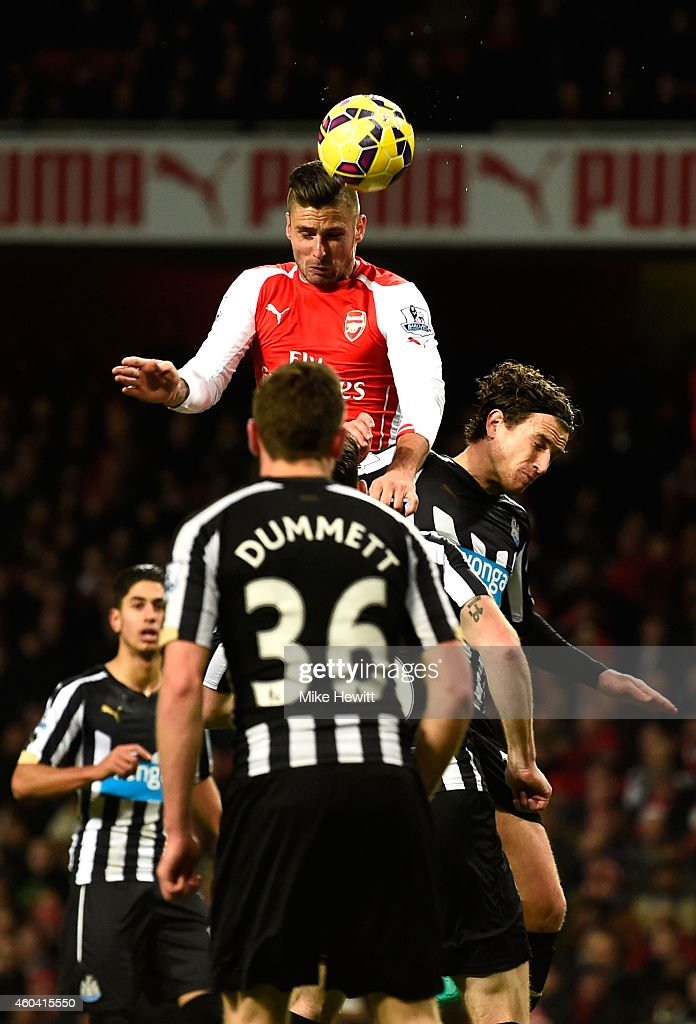 Olivier Giroud of Arsenal scores the opening goal during the Barclays Premier League match between Arsenal and Newcastle United at Emirates Stadium on December 13, 2014 in London, England.