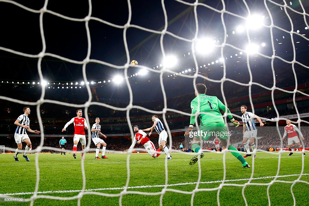 Olivier Giroud of Arsenal scores the opening goal during the Premier League match between Arsenal and West Bromwich Albion at Emirates Stadium on December 26, 2016 in London, England.