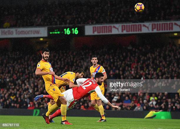 Olivier Giroud of Arsenal scores the opening goal during the Premier League match between Arsenal and Crystal Palace at the Emirates Stadium on...